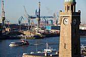 View over Landungsbruecken to dockyards, St. Pauli, Hamburg, Germany
