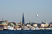 Harbor and St. Michaelis Church, viewing balloon in background, Hamburg, Germany