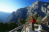 Woman at lookout point above Samaria Gorge, Crete, Greece