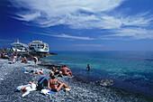 People on a beach, ferries in the background, Agia Roumeli, Samaria Gorge, Crete, Greece