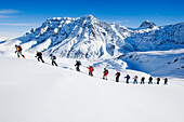 Large group of skiers ascending a mountain, Safiental, Grisons, Graubuenden, Switzerland, Alps