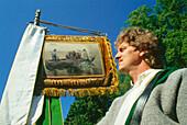 Mid adult man at procession, Corpus Christi, Chiemsee, Bavaria