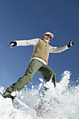Young woman having fun in winter landscape