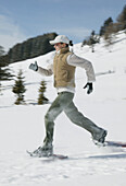 Young woman running in winter landscape
