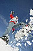 Girl jumping with snowshoes