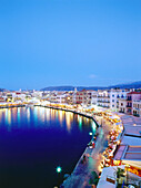 Illuminated Venetian Harbour at night with restaurants, Chania, Crete, Greece