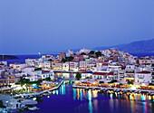 Agios Nikolaos at Voulismeni Lake in the evening, Crete, Greece