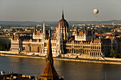 Parliament and Danube river, View to the Parliament and Budapest-Eye balloon over the Danube river, Pest, Budapest, Hungary