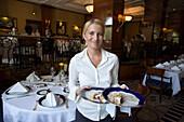 Waitress serving dessert, Waitress serving dessert in the restaurant Gundel, Pest, Budapest, Hungary