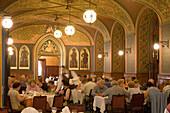 People in the Karpatia Restaurant, Waiter attending on guests in the Karpatia Restaurant, Pest, Budapest, Hungary