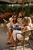 Women in open-air cafe, Two women sitting in an open-air Cafe at Liszt Square, Pest, Budapest, Hungary