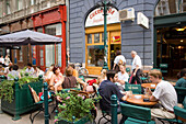 People in an open-air restaurant, People sitting in an open-air restaurant at Raday Street, Pest, Budapest, Hungary