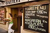 Waitress serving beer, Waitress serving beer in an open-air restaurant at Vaci Street, Pest, Budapest, Hungary