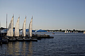 Sailing boats on a sunny day on the river Aussenalster, Hamburg, Germany