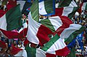 Italian soccer fans swaying flags