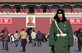 Young Chinese Guard Soldier on Tiananmen-Square, Picture of Mao-Tsetung above entry to forbidden city