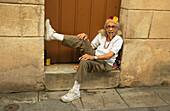 Old cuban woman sitting in front of a door smoking a cigar, La Bodeguita del Medio, Havanna