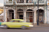 Old House on Havana's Malecon, oldtimer drives by, Cuba