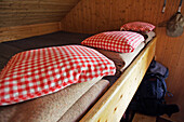 Pillows and woolen blankets in a refuge, Forno Hut, Bergell, Bregaglia, Graubuenden, Grisons, Switzerland, Alps.