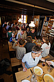 Mountaineers and hikers having dinner in a mountains hut, Forno hut, SAC, Swiss Alpine Club, Bergell, Bregaglia, Grisons, Switzerland, Alps