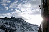 Man ice climbing, Stanley Headwall, Nightmare on Wolfstreet M7, British Colombia, Canada