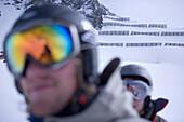 Two young people wearing ski googles, Kuehtai, Tyrol, Austria