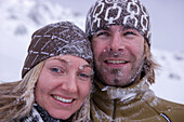 Young couple snuggling together, faces full of snow, Kuehtai, Tyrol, Austria