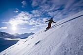 Young woman snowboarding, Kuehtai, Tyrol, Austria