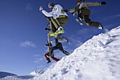 Group of young people jumping on snow, Kuehtai, Tyrol, Austria