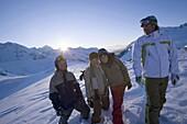 Group of young people standing on ski slope, Kuehtai, Tyrol, Austria