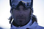 Young man wearing ski googles, portait, Kuehtai, Tyrol, Austria