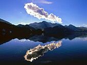 Clouds reflecting on water surface, Kochelsee, Upper Bavaria, Germany