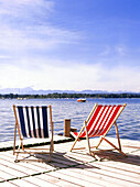 Stripy deckchairs on jetty, Starnberger See, Upper Bavaria, Deutschland