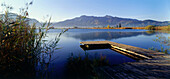 Wooden pier over body of water, Lake Eichsee, Upper Bavaria, Germany