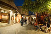 People strolling over shopping street Odos Ifestou with souvenir shops in the evening, old town, Kos-Town, Kos, Greece
