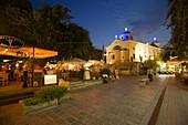 Illuminated restaurant near Agia Paraskevi church at night, Kos-Town, Kos, Greece