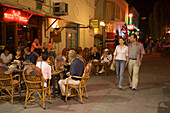People sitting in a pavement cafe at night, Kos-Town, Kos, Greece