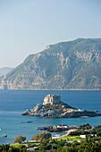 View over basilica Agios Stefanos at Kefalos beach to Kastri Island with St. Nicholas, Kos, Greece