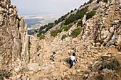 Women hiking to summit of Dikeos mountain, Zia, Kos, Greece