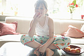 Girl sitting on table,eating an apple