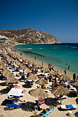 View to the Elia Beach with a lot of sunshades and bathers, Elia, Mykonos, Greece