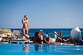 Women at the pool of the Goya Beach Bar, the only beach bar with pool, at Paranga Beach, Mykonos, Greece