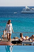 Women at the pool of the Goya Beach Bar, the only beach bar with pool, at Paranga Beach, Mykonos, Greece