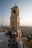 People visiting the Agios Georgios Chapel on the Lykavittos Hill, at viewing point near bell tower, Athens, Athens-Piraeus, Greece