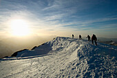 Four skier heading towards to Titlis summit, Central Switzerland