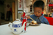 kid, child,young boy Superman toy eating dumpling, biaozi, Little Emperor