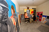 Lao Fan,Painter Lao Fan in his studio, paints chairman Mao in combination with, attractive and sexy girls, power, Vorsitzender Mao als Playboy, womanizer, red guards, Mao bible