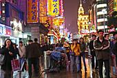 Shopping, Nanjing Road,Evening, Nanjing Road shopping, people, pedestrians, consumer, consume, beggar, rubbish bin, trash can, neon, advertising, rain