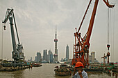 Harbour,View from Waibaidu Bridge, Huangpu-River, Pudong, line of freight barges, man with helmet