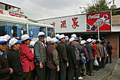 chinese tourists,bus tour, uniform cap, advertising, queue, old folks